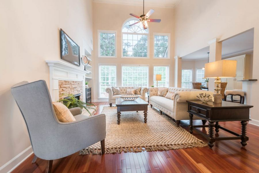 Vacant Home Staging Project in Canton, Georgia. Living room with gleaming hardwoods and neutral furnishings highlight the usability of the space.