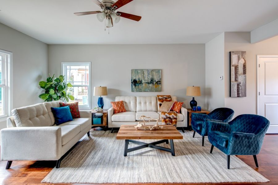 Transitional style Living Room in this Vacant Home Staging project in Norcross's Brookside Commons, two blue chairs and tufted sofa to the left.